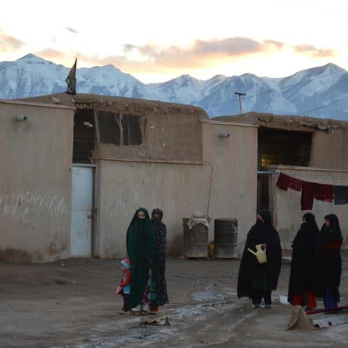 Afghan women refugees outside building